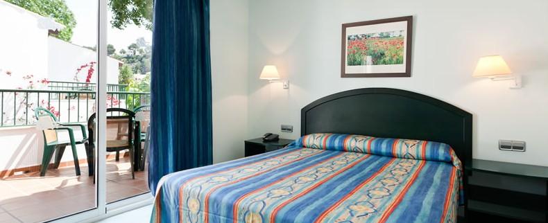 Hotel cala galdana villas d 39 aljandar en cala galdana for Hotel habitacion familiar zaragoza